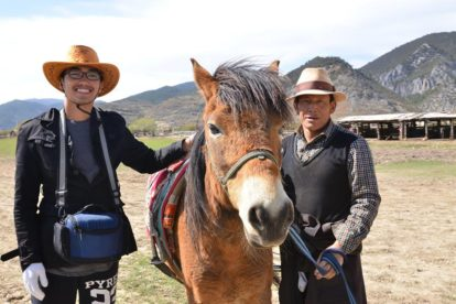 Learning the Tibetan way of horse riding.